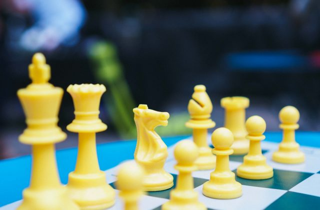 yellow chess pieces tournament