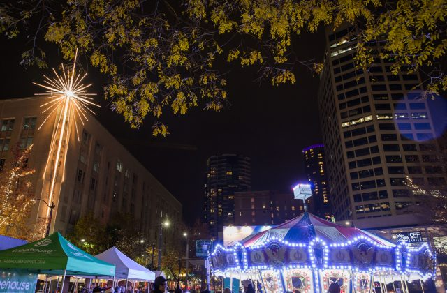 A lit holiday carousel in Westlake Park in downtown Seattle.