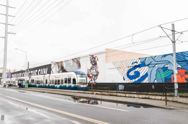 Train by a mural