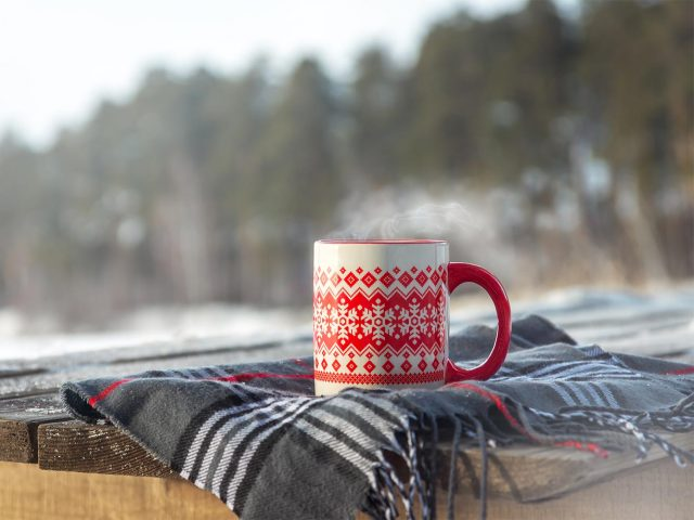 Holiday scarf and hot beverage